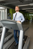 Businessman Exercising On A Treadmill Stock Image