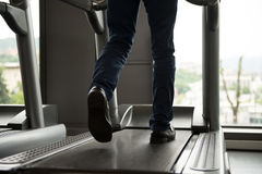Businessman Exercising On A Treadmill Stock Photo