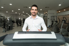 Businessman Exercising On A Treadmill Royalty Free Stock Photo