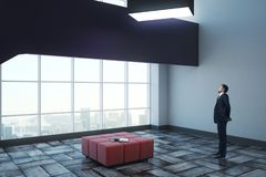 Businessman in exhibition hall. Side view of young businessman standing in modern exhibition hall interior with panoramic city view. Museum concept. 3D Rendering Stock Photo