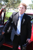 Businessman Exiting Vehicle Stock Photo