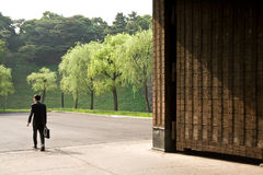 Businessman exits a gate. A man exiting a gate around Imperial Palace, Tokyo, Japan. June, 2007 Royalty Free Stock Photo