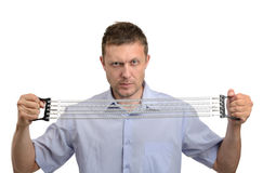 Businessman with expander Royalty Free Stock Photos