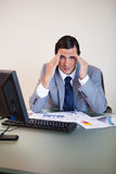 Businessman experiencing a headache Stock Photos