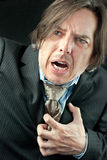 Businessman Experiencing a Heart Attack. Close-up of a businessman experiencing a heart attack Royalty Free Stock Images