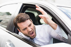 Businessman experiencing road rage. In his car Stock Photos