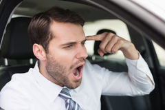 Businessman experiencing road rage Stock Images