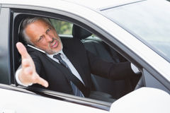 Businessman experiencing road rage Stock Photo