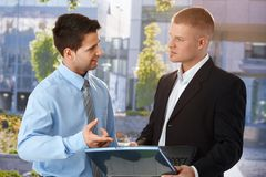 Businessman explaining colleague computer work stock photo