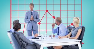 Businessman explaining colleagues in meeting with graph in background. Digital composite of Businessman explaining colleagues in meeting with graph in background Stock Photos