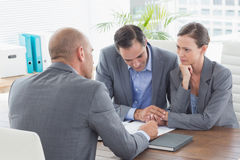 Businessman explaining contract to business partners Stock Images