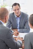 Businessman explaining contract to business partners Royalty Free Stock Photo