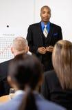 Businessman explaining financial analysis chart Stock Image