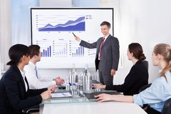 Businessman explaining graph Stock Images