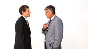 Businessman explaining something to his employee stock video footage