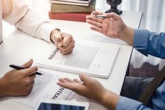 Businessman explaining terms and conditions with contract  insurance agreement before he sign the document. Business contract concept royalty free stock image