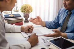 Businessman explaining terms and conditions with contract  insurance agreement before he sign the document. Business contract concept royalty free stock images