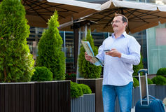 Businessman exploring the city guide Royalty Free Stock Image