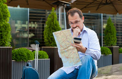 Businessman exploring the city guide Stock Images