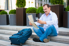 Businessman exploring the city guide Royalty Free Stock Photography