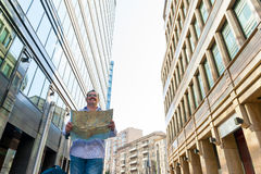 Businessman exploring the city guide. Middle age businessman exploring the city guide royalty free stock photography