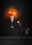Businessman with an explosion bulb Royalty Free Stock Photo