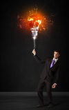 Businessman with an explosion bulb Royalty Free Stock Photography