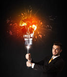 Businessman with an explosion bulb Royalty Free Stock Image