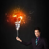 Businessman with an explosion bulb Royalty Free Stock Images