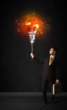 Businessman with an explosion bulb Royalty Free Stock Photos