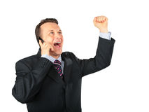 Businessman expressive speaks by cell phone Stock Photography