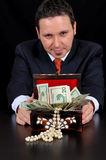 Businessman is extending gift box Royalty Free Stock Photo