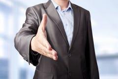 Businessman extending hand Stock Photo