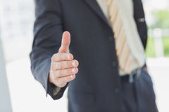 Businessman extending hand for handshake Royalty Free Stock Photos