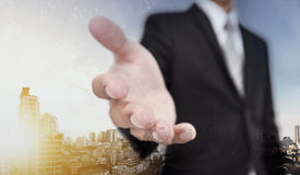 Businessman extending hand with panoramic cityscape of Bangkok city in sunrise Stock Photos