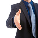 Businessman extending hand to shake Royalty Free Stock Photos