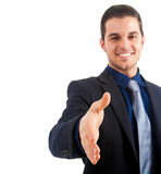 Businessman extending hand to shake Stock Photo