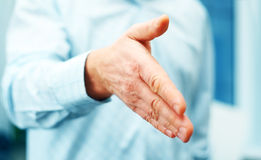 Businessman extending hand to shake Stock Photo