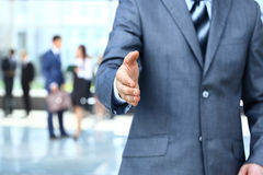 Businessman extending hand Royalty Free Stock Photo