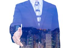 Businessman extending hand to shake with city scape. Royalty Free Stock Image