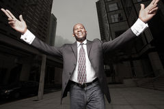 Businessman extending his arms Royalty Free Stock Image