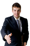 A businessman is extending his hand Stock Photography