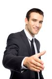 Businessman extending his hand for a handshake Stock Photos