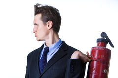 Businessman with extinguisher Royalty Free Stock Photography