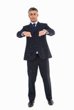 Businessman with eyes closed gesturing Stock Photography