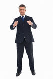 Businessman with eyes closed and open arms Stock Photo