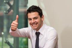 businessman face focus his ok selective showing sign thumb up Стоковые Изображения RF