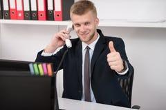 businessman face focus his ok selective showing sign thumb up Стоковая Фотография RF