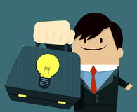 Businessman face smile and Showing Bag-Light Bulb. Businessman face smile and Showing Bag  - Light Bulb Stock Images