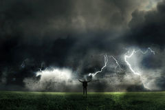 Businessman facing a great challenge. Businessman facing a thunder storm Stock Photo